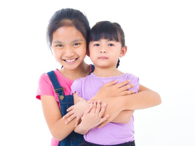 азиатские сестры стоковое фото rf