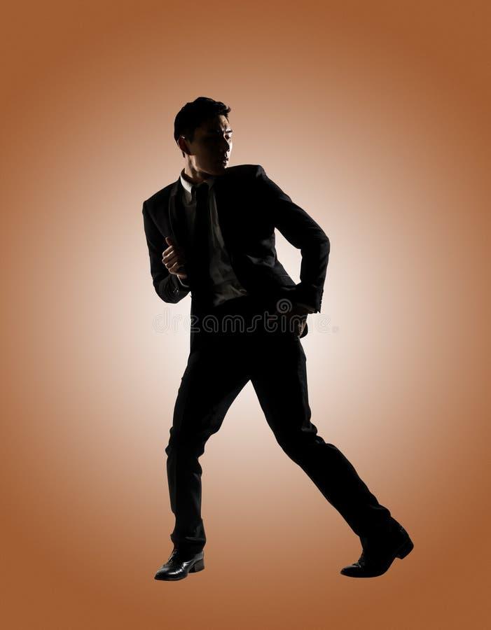 Азиатские танцы бизнесмена стоковые фотографии rf