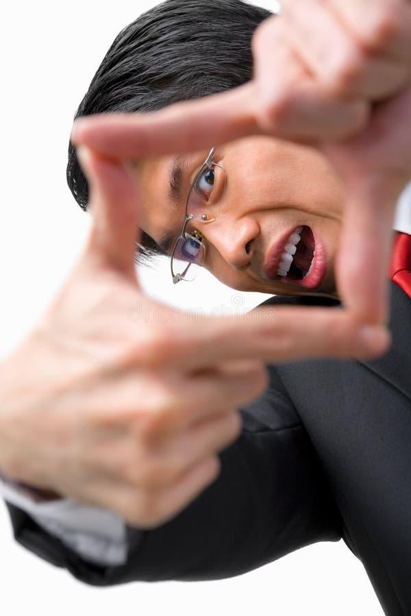 азиатский бизнесмен его смотреть perspetive стоковое изображение