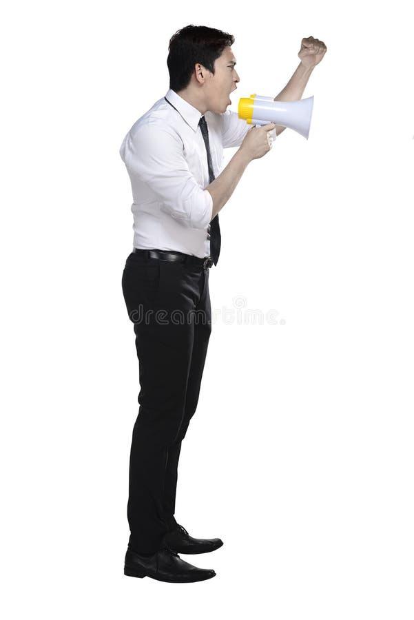 Азиатский бизнесмен держа мегафон стоковые фото