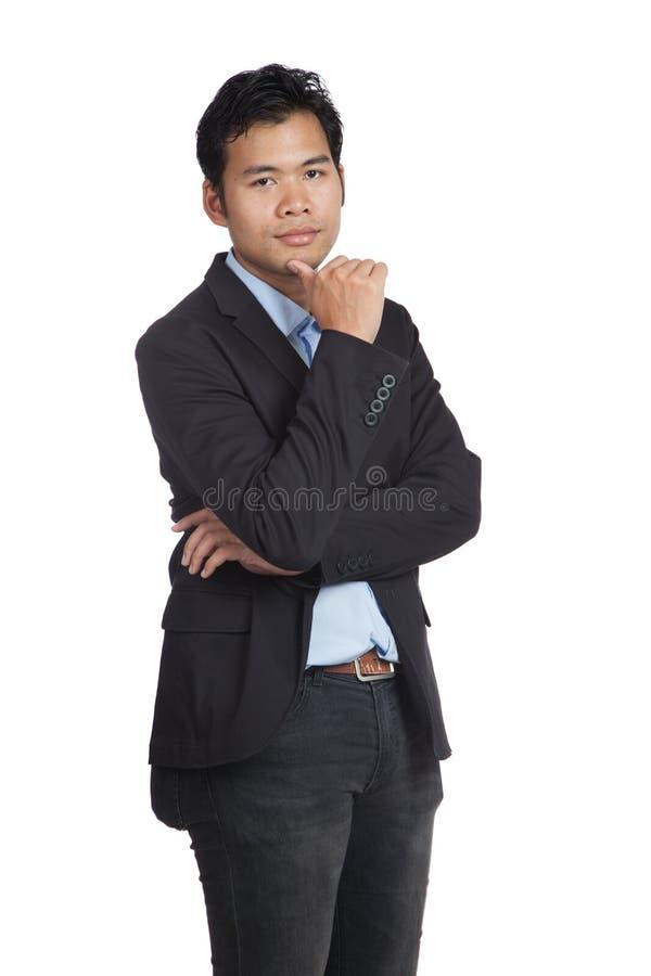 Азиатский бизнесмен думает взгляд на камере стоковая фотография rf
