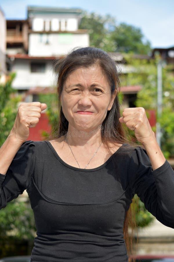 Азиатский женский старший и гнев стоковые изображения