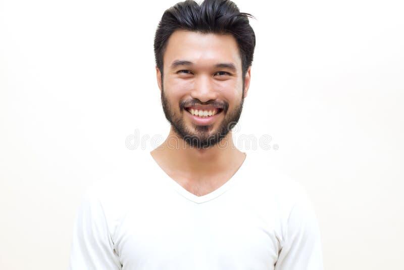 Азиатский красивый человек при усик, усмехаясь и смеясь над на whit стоковое фото rf
