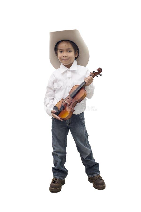 Азиатский мальчик нося ковбойскую шляпу держа скрипку стоковое фото rf