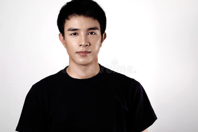 Азиатский портрет человека в студии стоковые фотографии rf