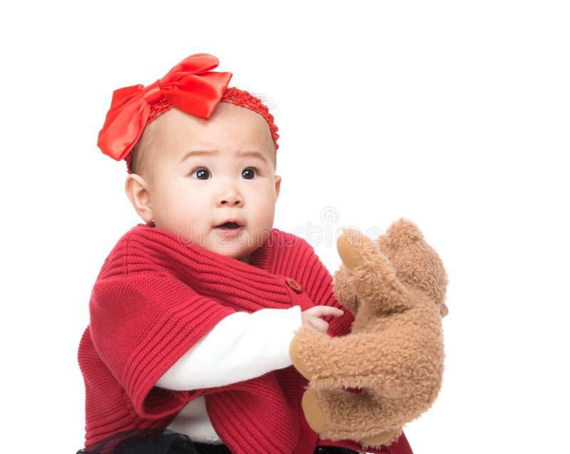 Download Азиатский ребёнок с куклой стоковое фото. изображение насчитывающей сторона - 37926522