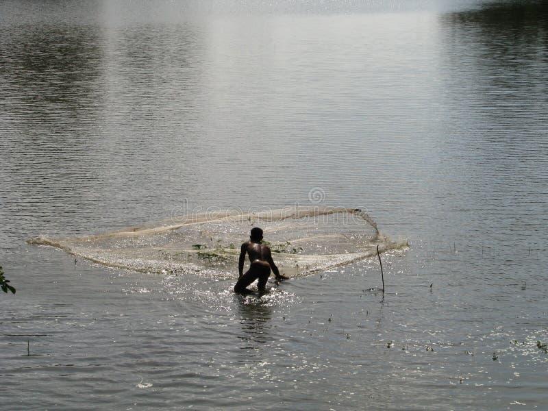 Азиатский рыболов стоковое фото