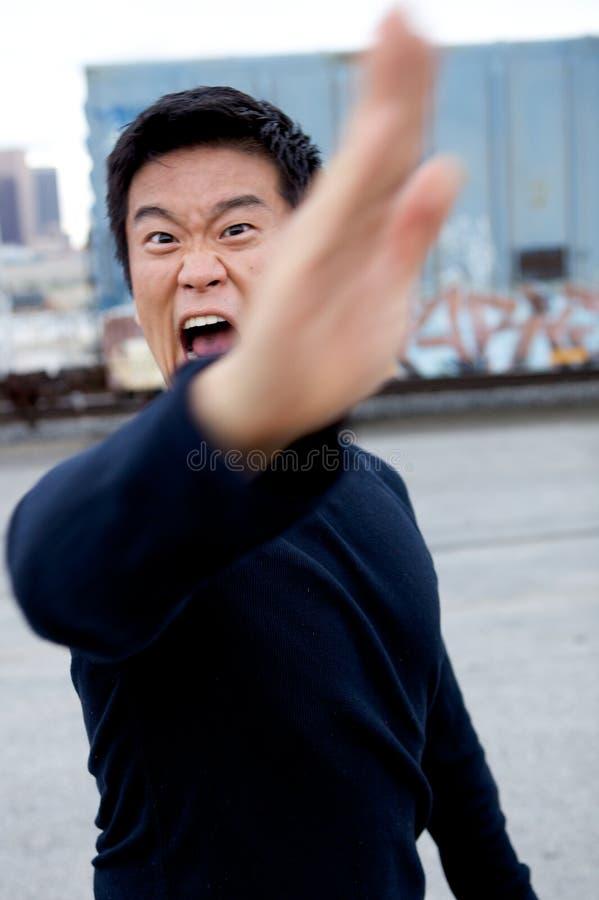 азиатский смешной человек карате стоковая фотография rf