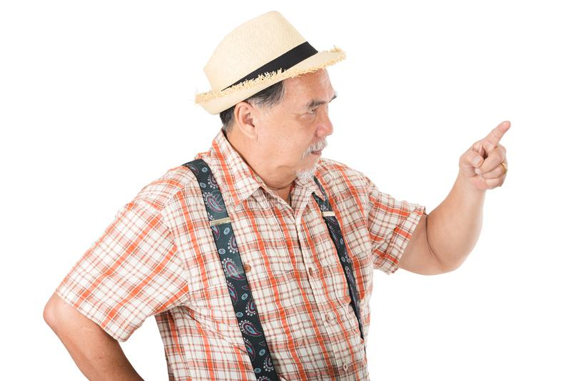 Азиатский старший человек сердитый стоковое фото rf