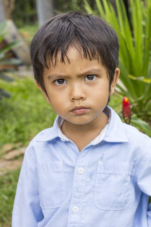 Азиатский тайский мальчик серьезный стоковые фотографии rf