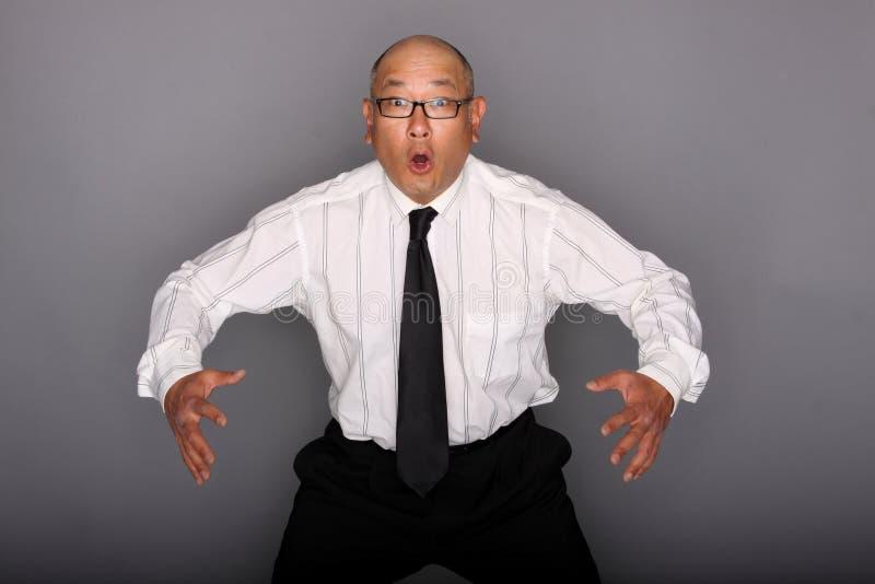 азиатский удивленный человек стоковые фотографии rf