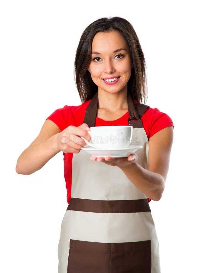 азиатский фокус кофейной чашки barista предпосылки изолировал сервировку показывая сь официантке детенышей белой женщины Молодой  стоковое фото rf