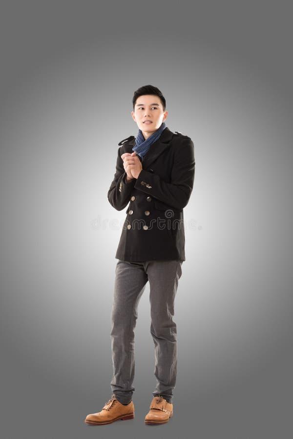 Азиатский холод чувства молодого человека стоковые изображения