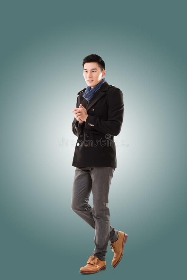 Азиатский холод чувства молодого человека стоковое изображение