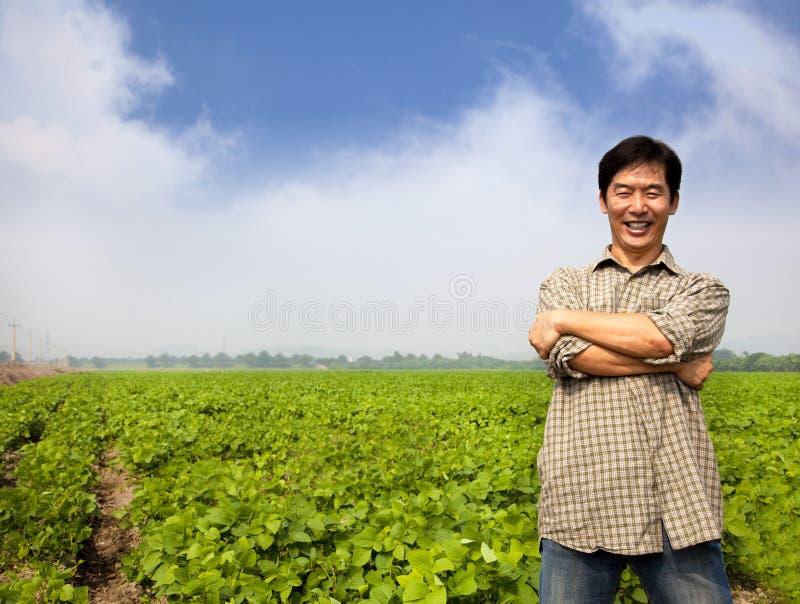 азиатский хуторянин успешный стоковое фото