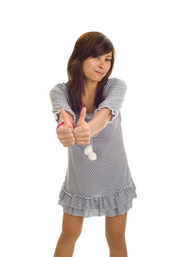 азиат thumbs 2 вверх по женщине стоковые изображения