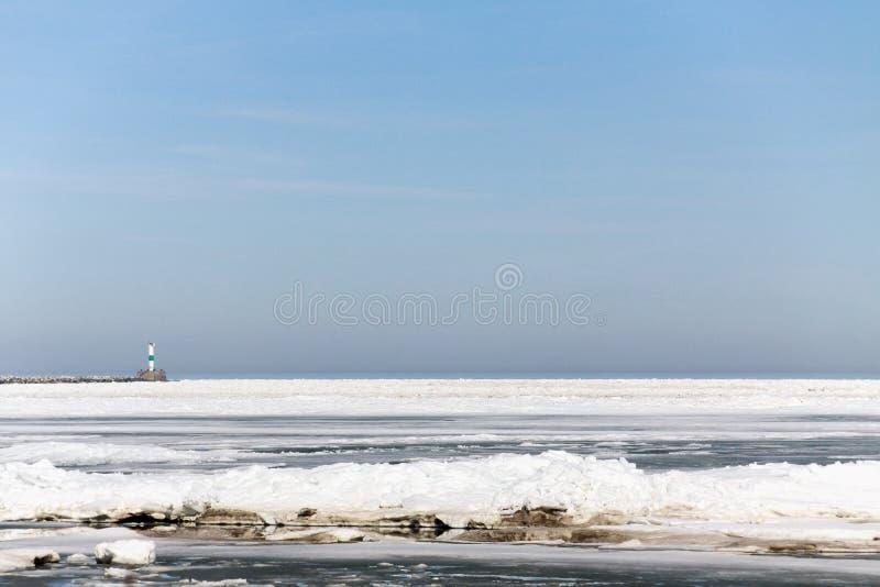 Айсберг в зиме с маяком стоковые изображения rf