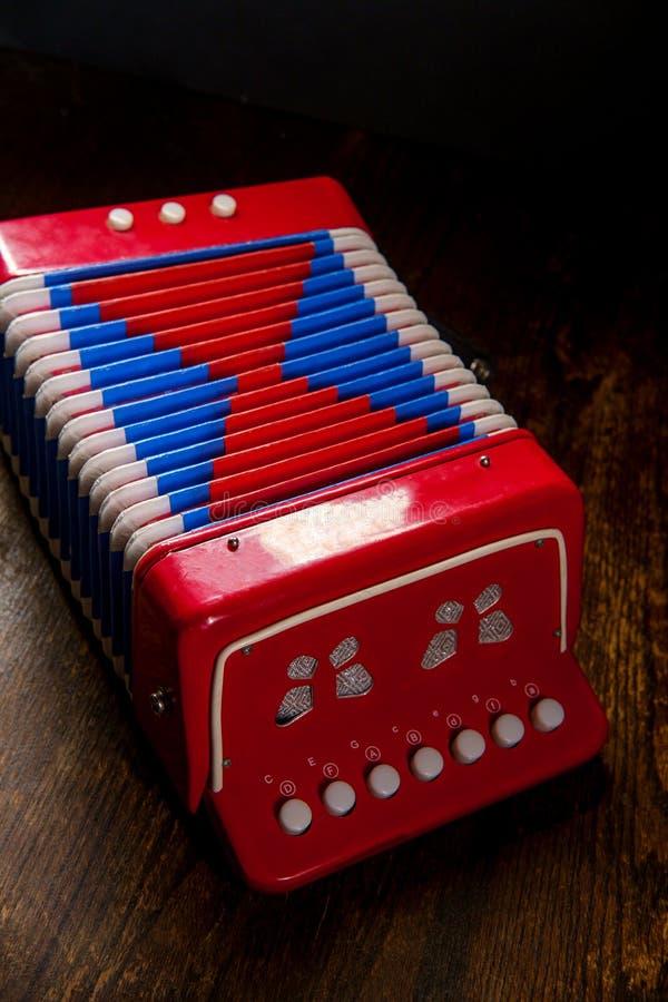 Аккордеон музыкального инструмента игрушки стоковые фото