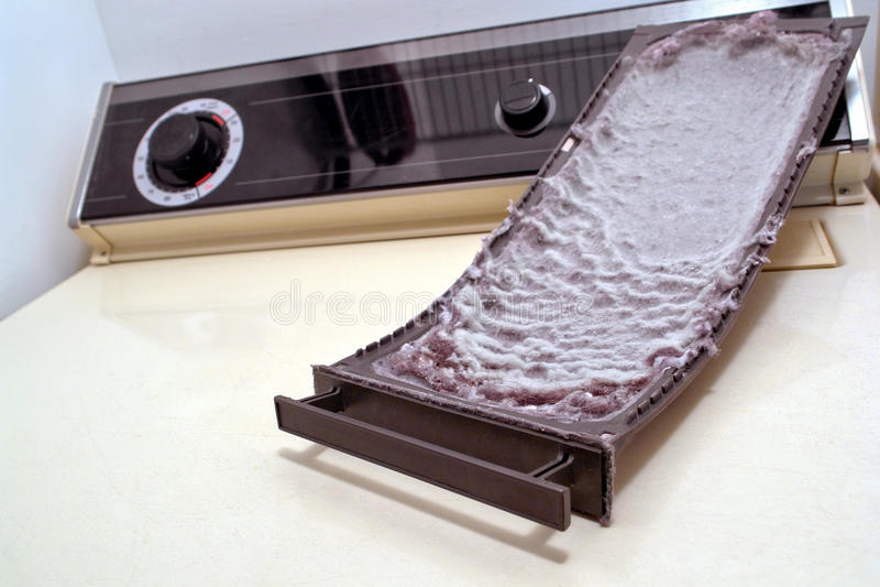 аккумулированная ловушка корпии одежд вниз более сухая стоковое изображение rf