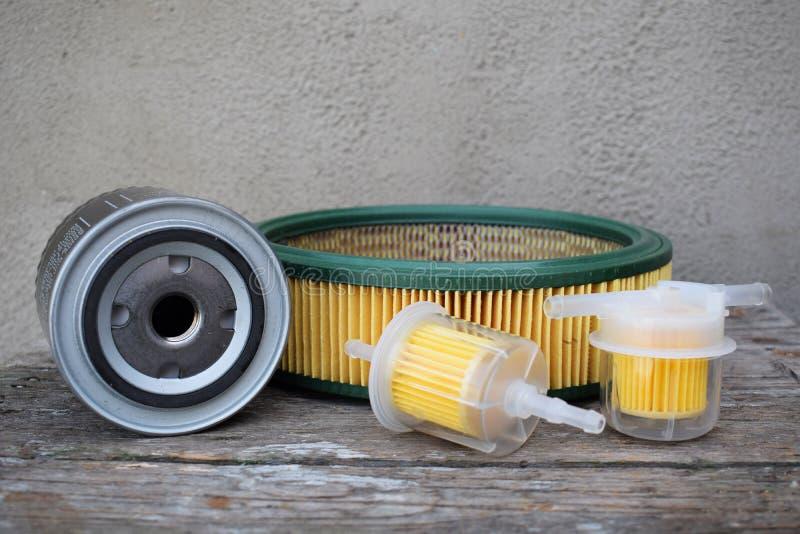 Аксессуары автозапчастей: масло, топливо или воздушный фильтр для автомобиля двигателя стоковое изображение rf