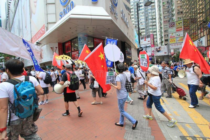 Активисты Гонконга маршируют впереди голосования на электоральном пакете стоковые фото
