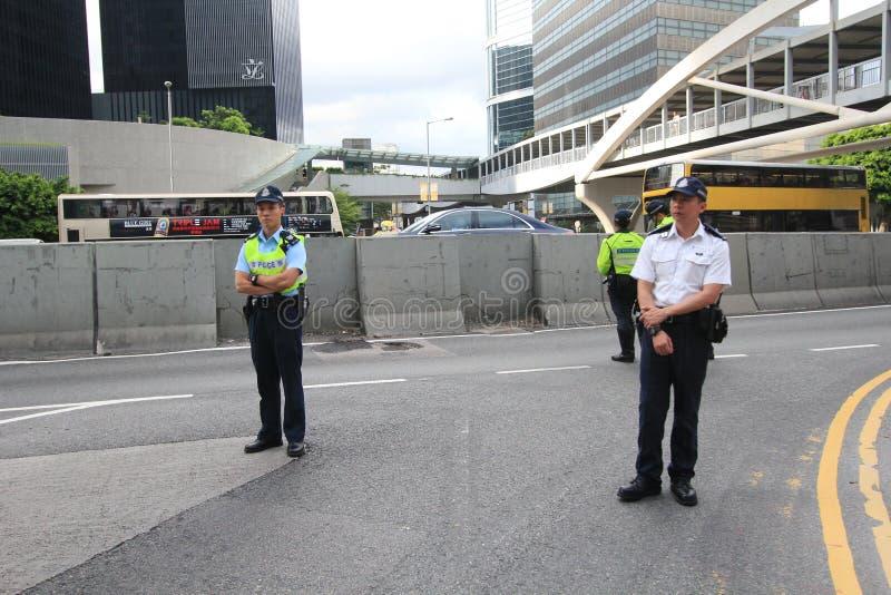 Активисты 2015 Гонконга маршируют впереди голосования на электоральном пакете стоковые изображения rf
