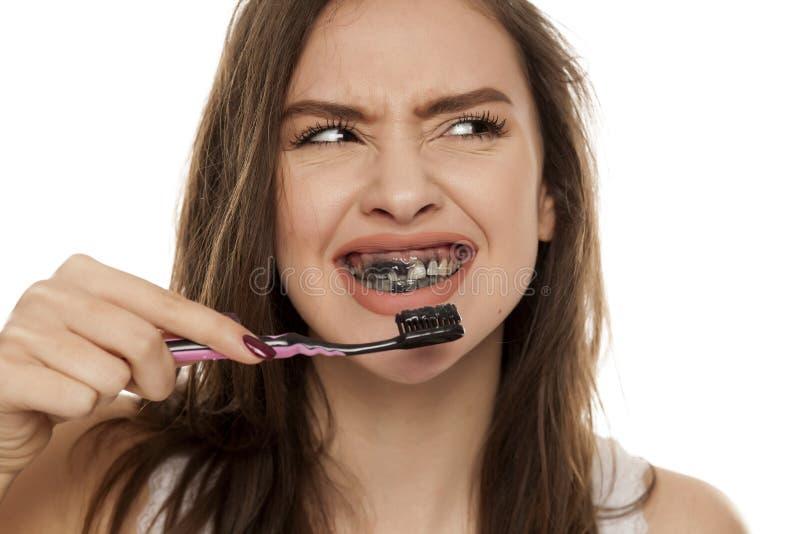 Активная зубная паста угля стоковое изображение
