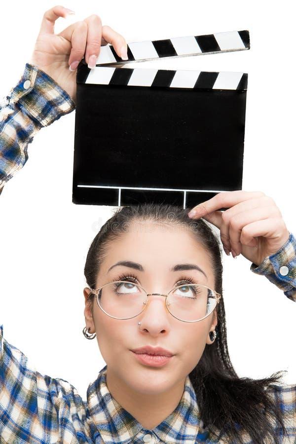 Актриса подростка с космосом экземпляра черноты нумератора с хлопушкой кино стоковые фотографии rf