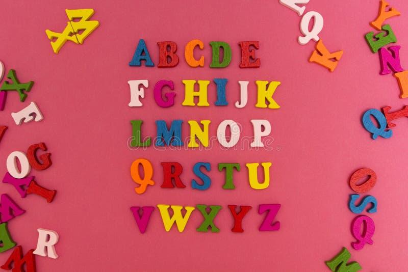 Алфавит детей на розовой предпосылке стоковое изображение rf