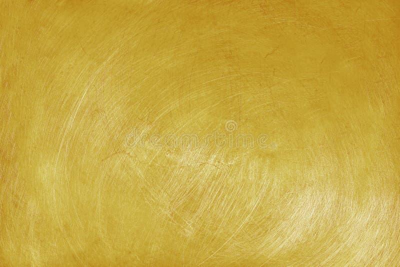 Алюминиевая предпосылка текстуры с золотым цветом, картиной царапин на нержавеющей стали стоковые изображения
