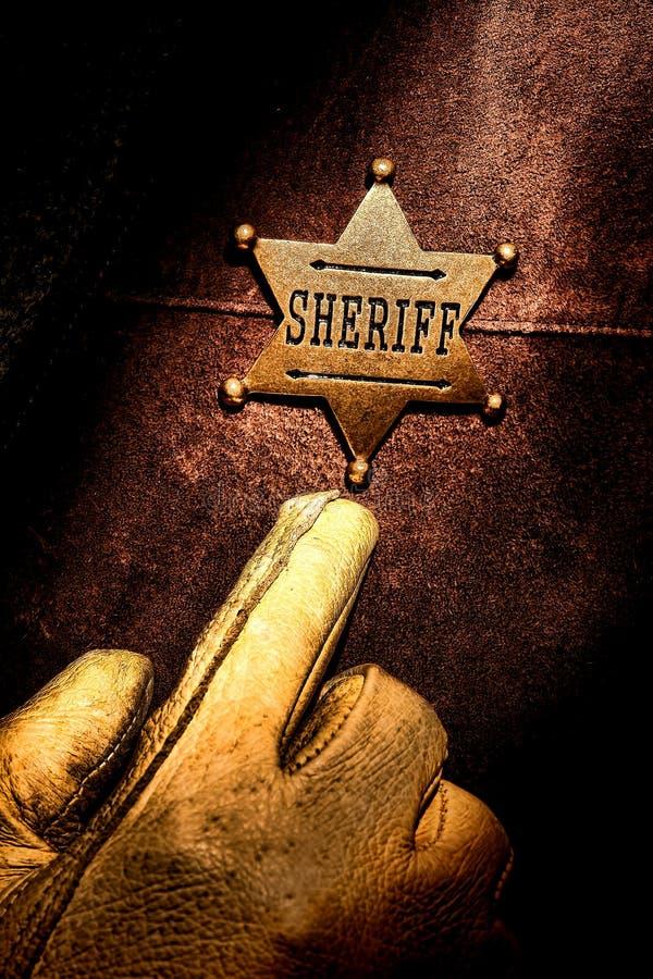 Американский западный указывать перста значка шерифа сказания стоковое фото rf