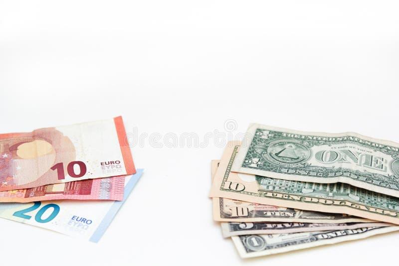 Американское евро и доллары банкнот для дизайна дела Счеты различной валюты денег наличных денег бумажные на белой предпосылке стоковые фото