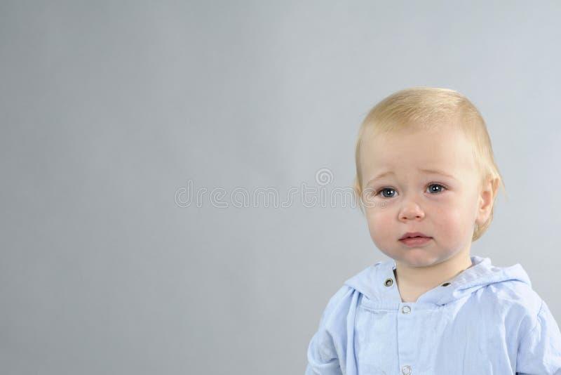 анализирующ ребёнок унылый стоковое фото