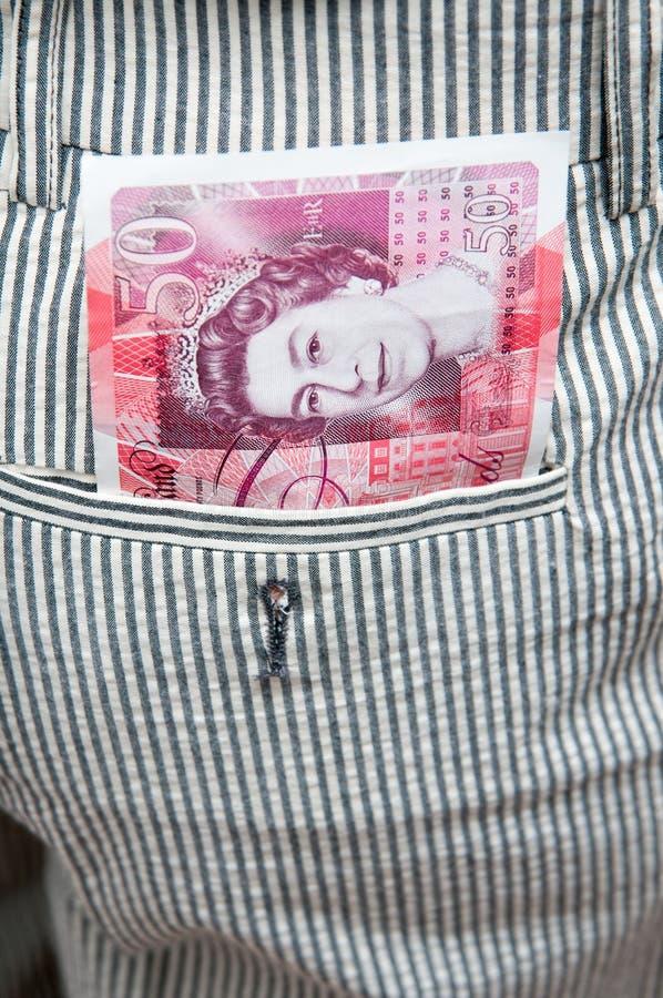 Английские фунты в карманн стоковая фотография rf