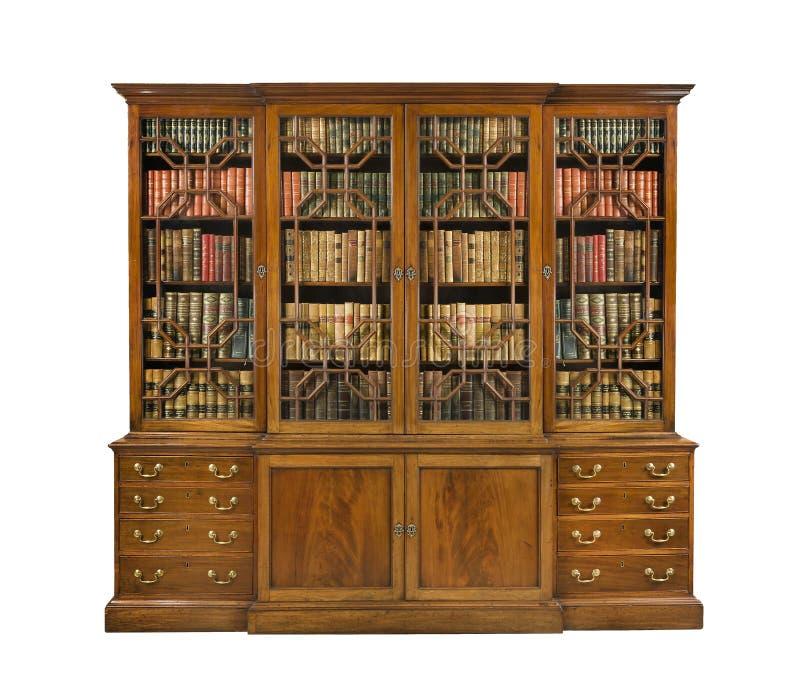Английский язык Bookcase старый античный с книгами стоковая фотография