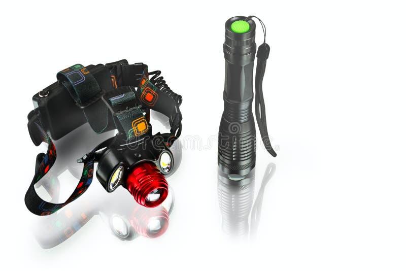 Анодированные алюминиевые водоустойчивые тактические электрофонарь и headlamp стоковое изображение rf