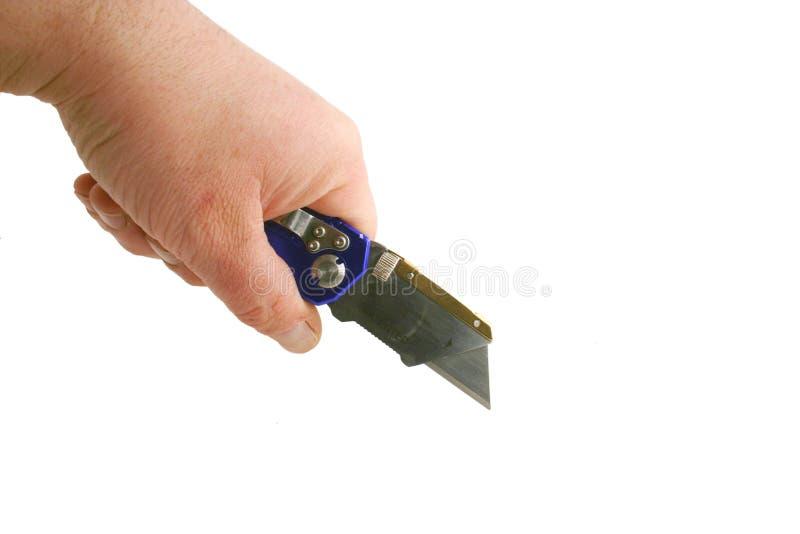 анодированные голубые контракторы вручают бритву ножа удерживания стоковые изображения