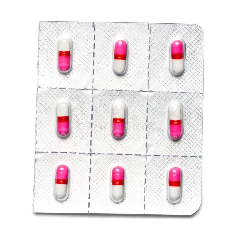 Антигистамин Caplets на белой предпосылке стоковые изображения rf