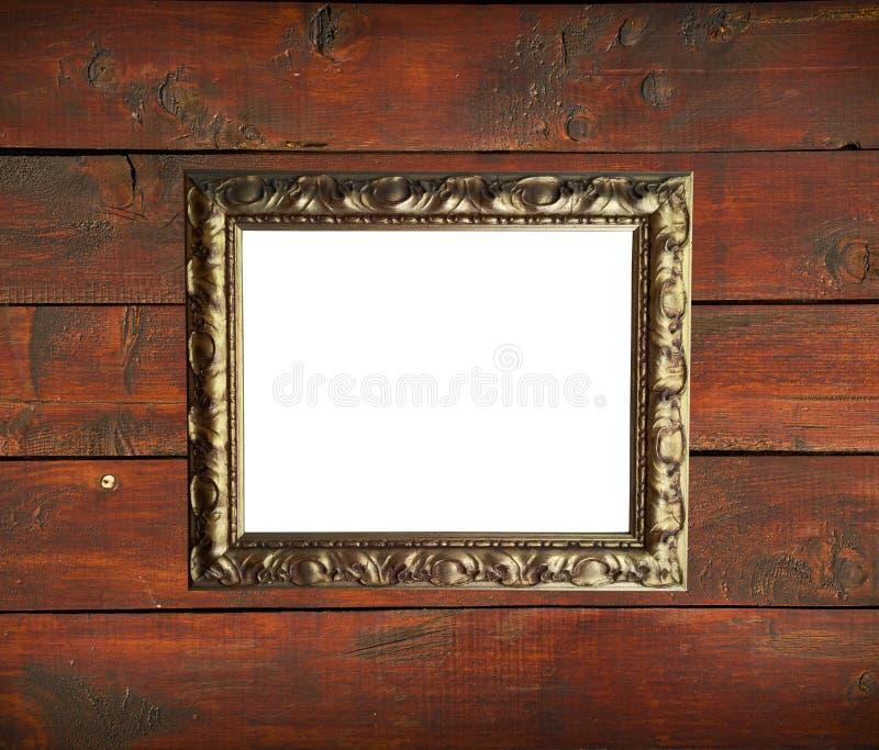 Античная золотая рамка на деревянной стене стоковые изображения rf