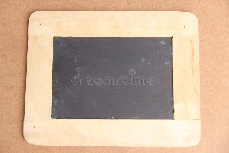 Античная доска с деревянной рамкой стоковое фото
