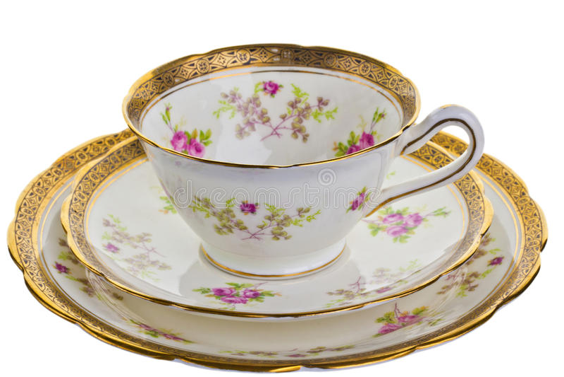Античная чашка, поддонник и малая плита. стоковая фотография rf