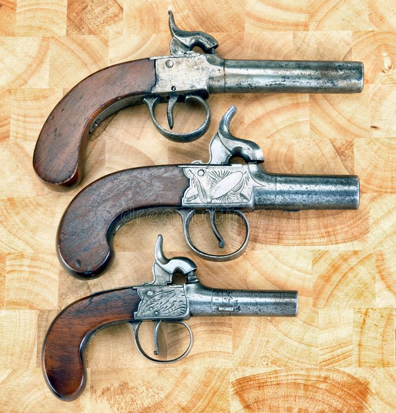 Античные пистолеты халявы стоковое фото