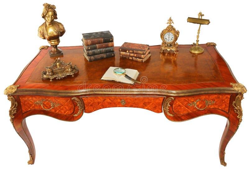 Античный королевский стол сочинительства с книгами стоковое фото