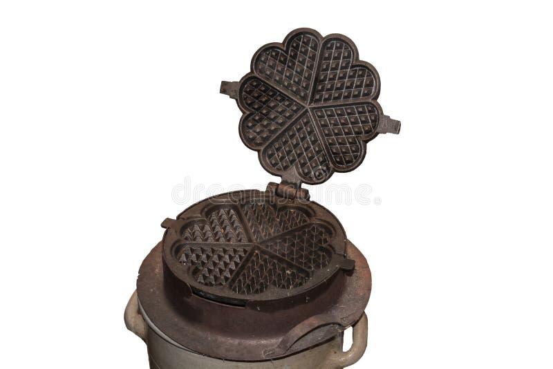 Античный утюг waffle циннамона от литого железа стоковое изображение