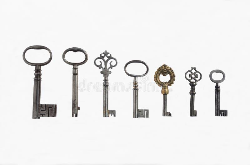 7 античных ключей трубы стоковое фото