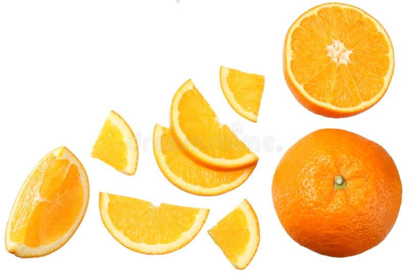 Апельсин при куски изолированные на белой предпосылке еда здоровая Взгляд сверху стоковое фото