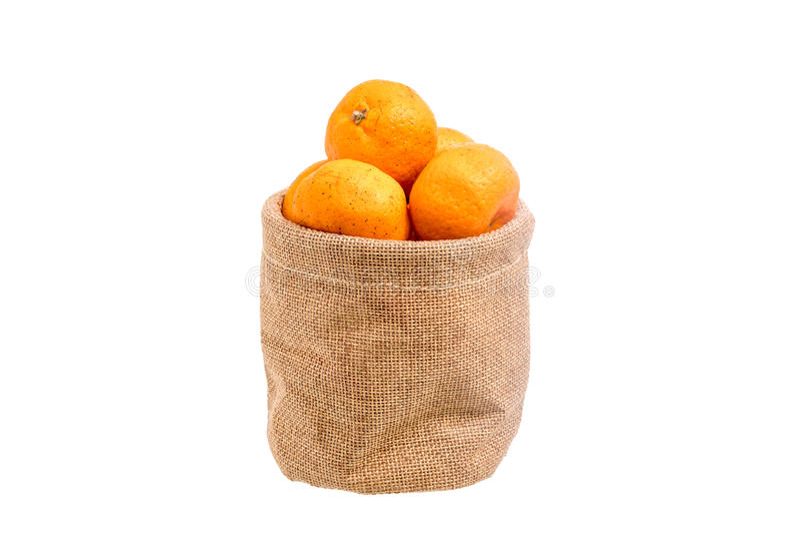 Апельсины в малом мешке стоковое изображение