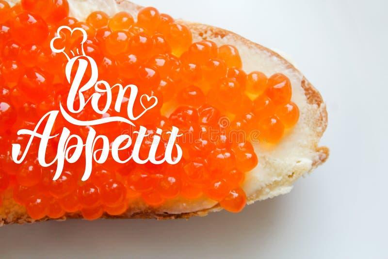 Аппетитная красная фраза литерности appeit сэндвича и bon икры стоковая фотография rf