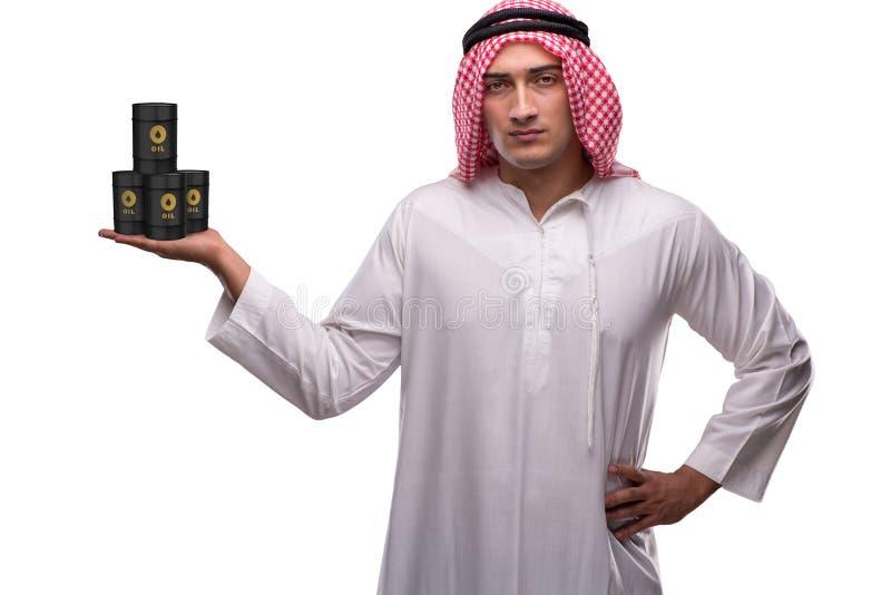 Арабский бизнесмен держа бочонок масла на белой предпосылке стоковые изображения rf
