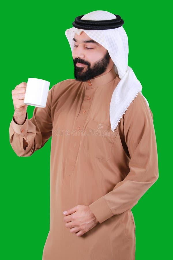 Арабский человек держа стекло стоковые изображения rf